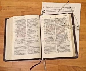 Bible, glasses, notes for 6-8-15 on wood